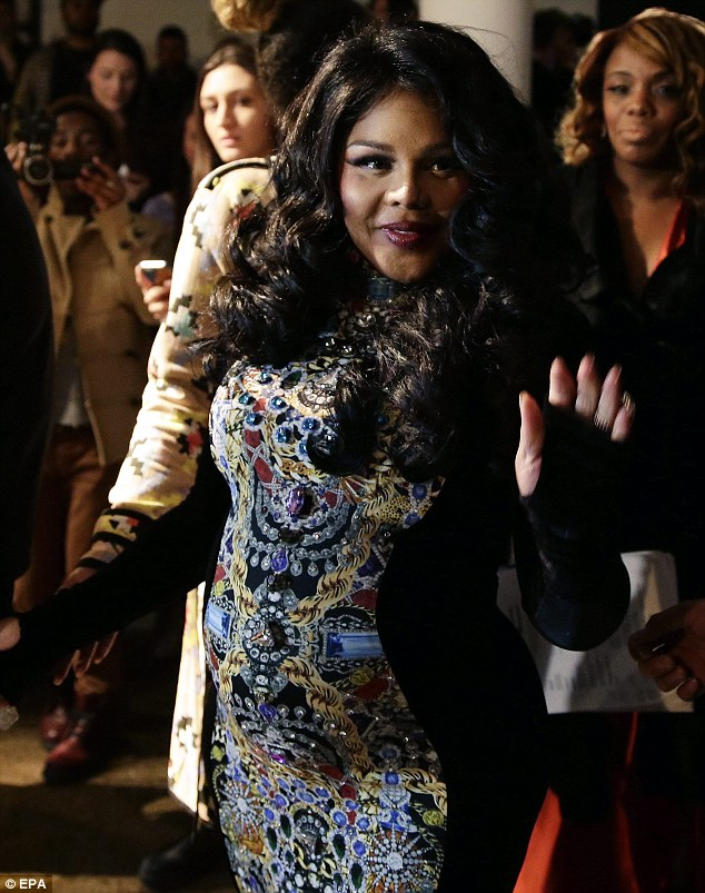 Tum-thing to tell us? Lil' Kim shows off a noticeable bump on Wednesday evening during NYFW prompting rumours she is now pregnant