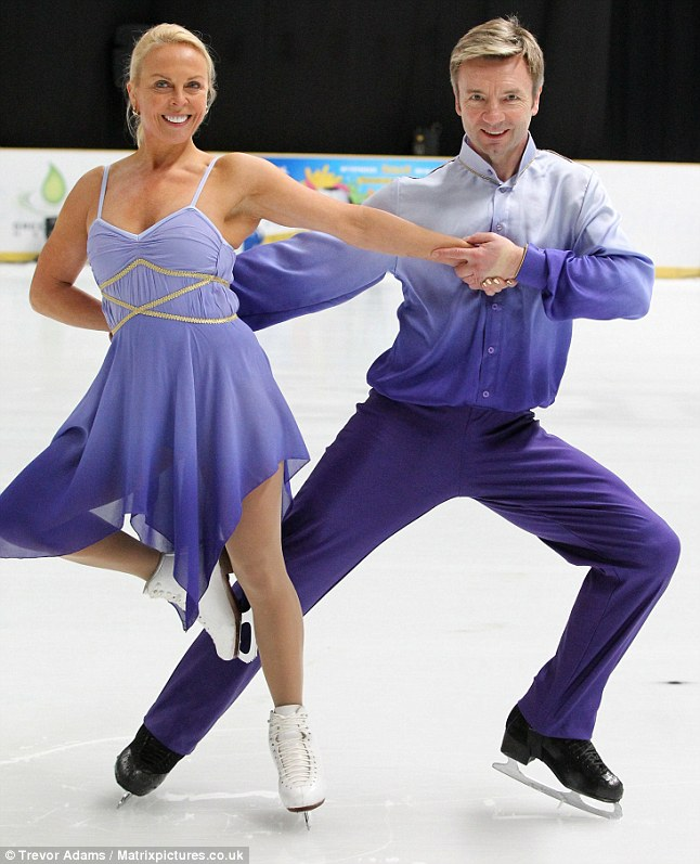 Still smiling: Jayne Torvill and Christopher Dean recreated their famous purple Olympic costumes for the photocall