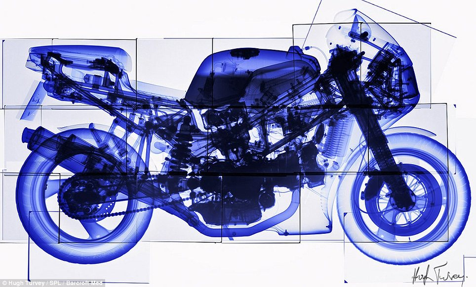 Mechanical marvel: The inner workings of this motorbike are exposed by Mr Turvey's barrage of x-rays
