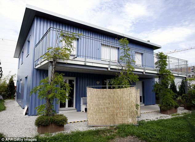 Building of the Dignitas assisted suicide clinic, near Zurich: Assisted suicide is where doctors help patients to take their own lives, while euthanasia is where doctors take the lives of patients after being given permission