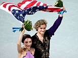 Gold medalists Meryl Davis and Charlie White of the United States celebrate during the flower ceremony for the Figure Skating Ice Dance on Day 10 of the Sochi 2014 Winter Olympics at Iceberg Skating Palace on February 17, 2014 in Sochi, Russia