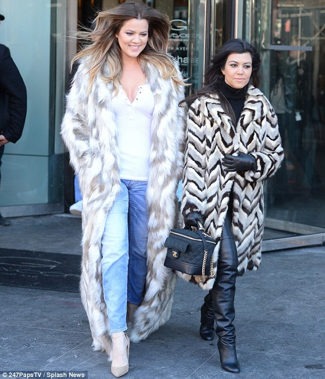 Something to tell us? Khloe gave a cheeky smile as she walked out of the DASH store with her sister Kourtney... as they filmed their reality show