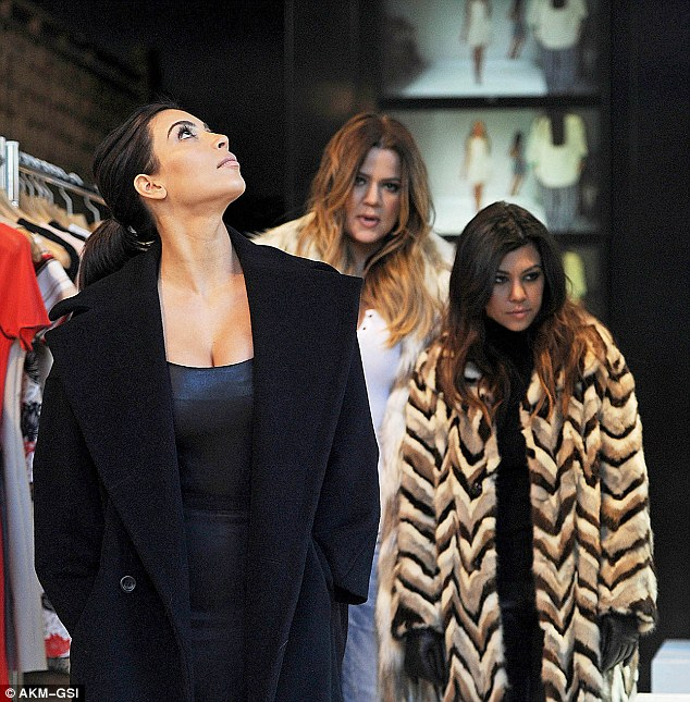 Something wrong? At one point Khloe and Kourtney looked less than impressed as they trailed behind their sister Kim