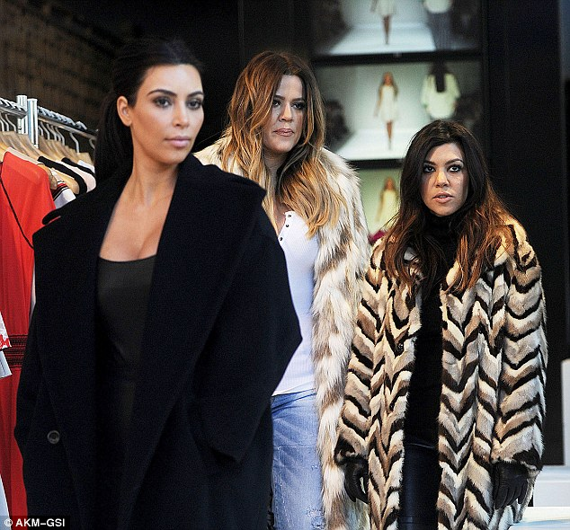 Keep up, girls! Kim lead the way as she, Khloe and Kourtney surveyed their DASH store in New York on Monday