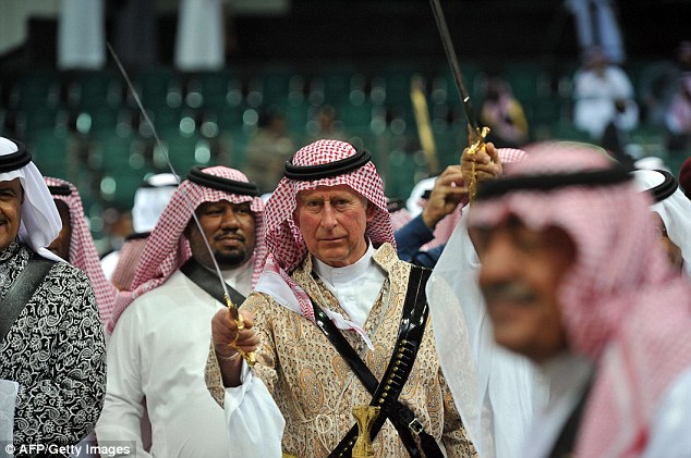 Prince Charles dances with sword during the traditional Saudi dancing best known as 'Arda'