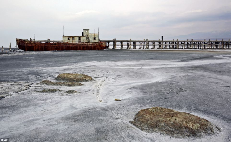 An abandoned ship is stuck in solidified salt at Lake Oroumieh. The shrinking has been blamed on climate change