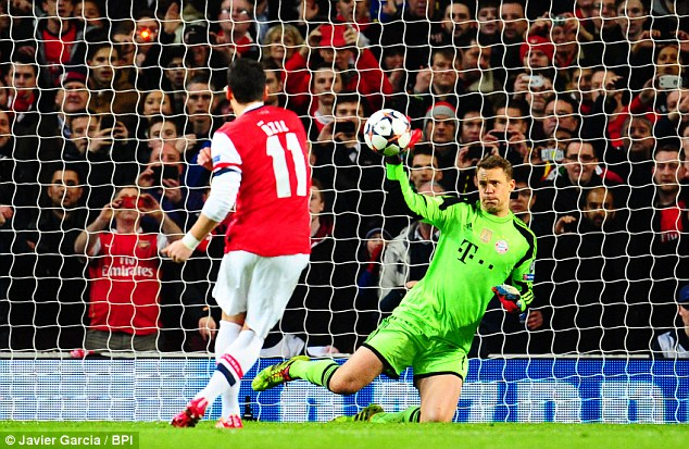 Not good enough: But goalkeeper Manuel Neuer wins the duel by palming away Ozil's weak shot