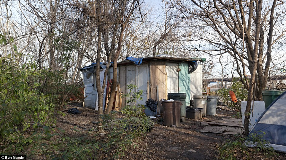 While most of the camps Marcin came across used basic tarps or tents, several were quite elaborate such as this home built entirely of wooden doors