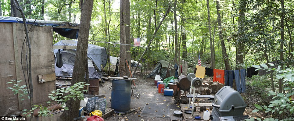Living off the grid: While some homes comprised a sheet over a branch, this settlement had a clothes line, barbecue and gym equipment