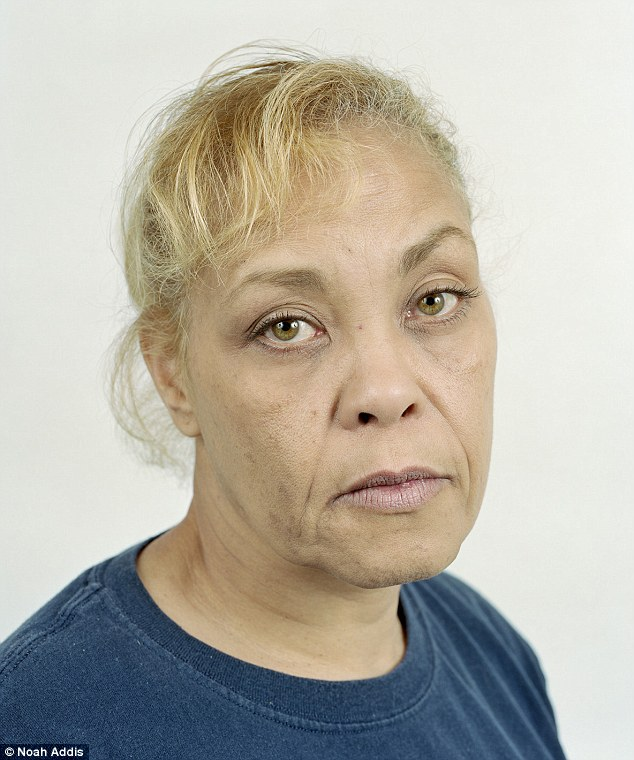 """Carol Jean """"Jeannie"""" Moton poses for a portrait at her home in Avella, Pa on April 29, 2012. Moton says she has had health problems including skin lesions and rashes, hot flashes and bone pain since the first Marcellus Shale well was drilled near her home in 2006. She says several of her neighbors, including her mother, have become ill. She suspects that contaminated water contributed to the recent death of her father as well as the death of her dog and her neighbor's dog. """"This is not a safe practice"""", she said, """"I've been through hell."""""""