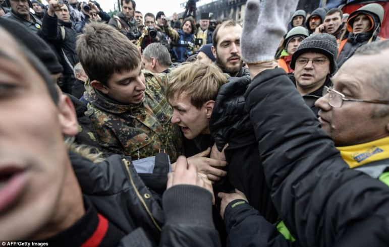 The regime of Ukraine's president appeared close to collapse on February 22 as the emboldened opposition took control of central Kiev