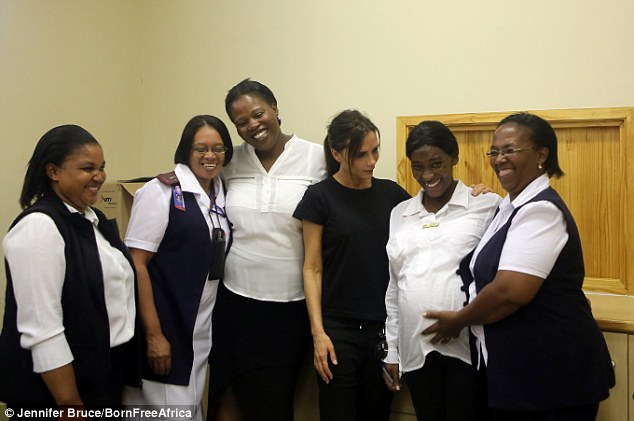 Touching: Victoria also posed with staff from the Mother2Mother programme at the Delft Community Health Centre in Cape Town
