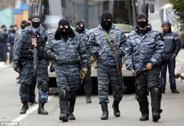 Begging for forgiveness: Members of Berkut anti-riot unit prepare to leave their barracks in Kiev