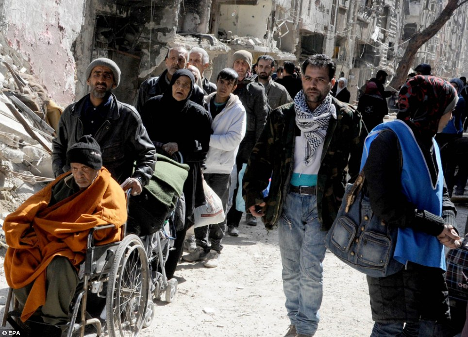 Helping hands: Sick and starving Palestinian residents hope to get a spot on ambulances provided by UNRWA