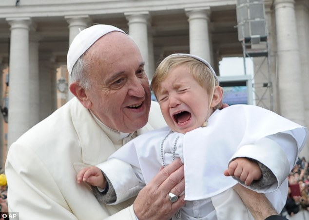 Mini-me: Pope Francis lifts up 19-month-old Daniele De Sanctis, dressed up as a pope, during his weekly general audience in St. Peter's Square at the Vatican