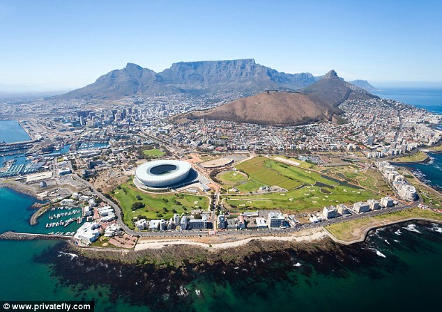 Cape Town Airport - which bears a striking resemblance to the Thunderbirds Tracy Island - is surrounded by dramatic mountain ranges, and nestled just below - a sprawl of squatter shacks