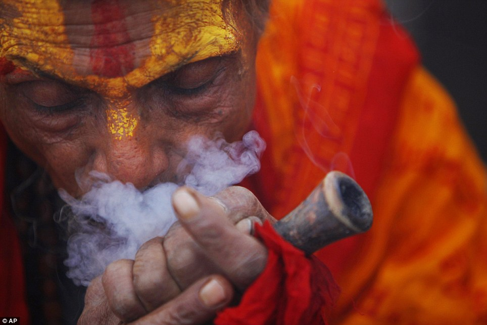 Drugs: Many Sadhu, such as this one photographed in the courtyard of Nepal's Pashupatinath Temple, use cannabis to help them get into the right frame of mind