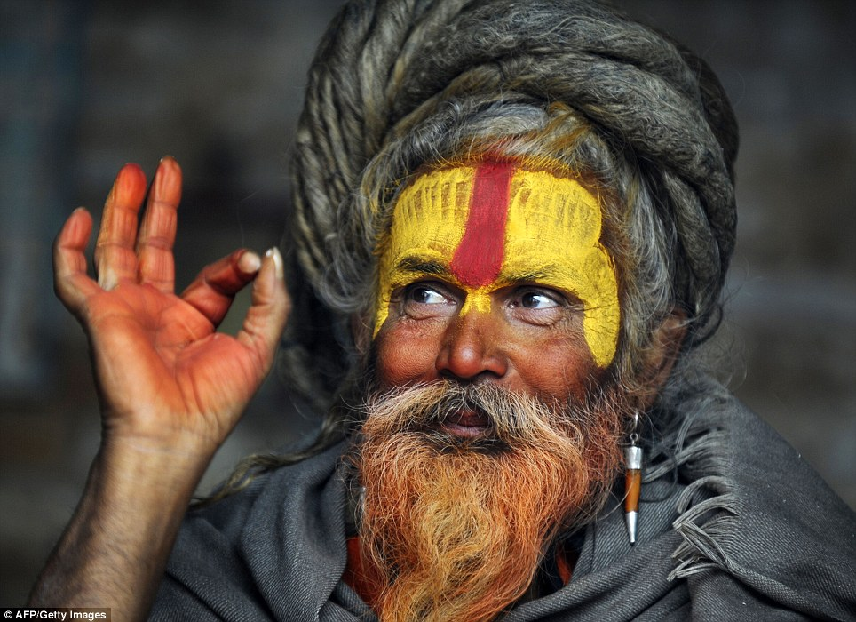 Honour: Along with painting their faces with representations of sacred images or symbols, many Sadhu dye their beards with saffron in honour of the gods