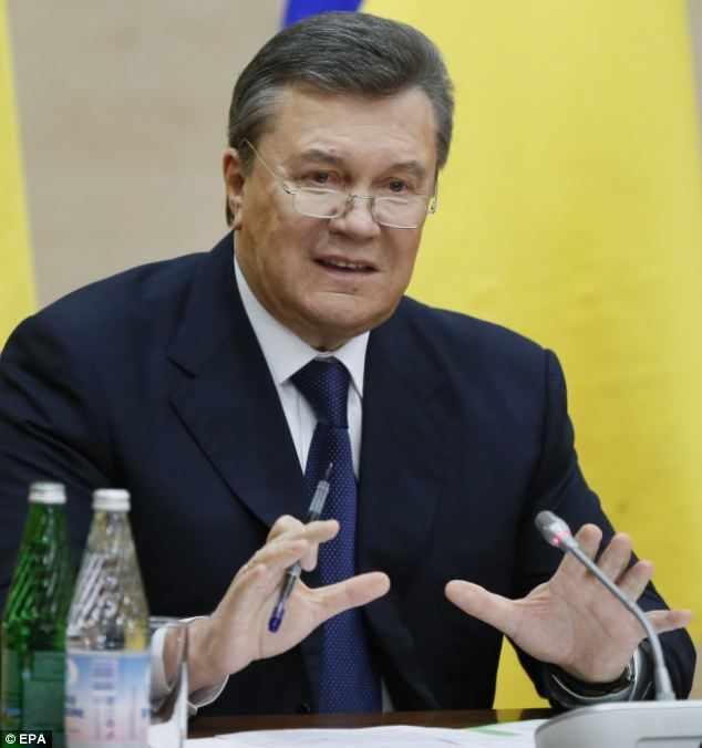 Ukraine's ex-President Yanukovych has made his first public appearance since being ousted, telling a news conference that he was going to fight for his country's future