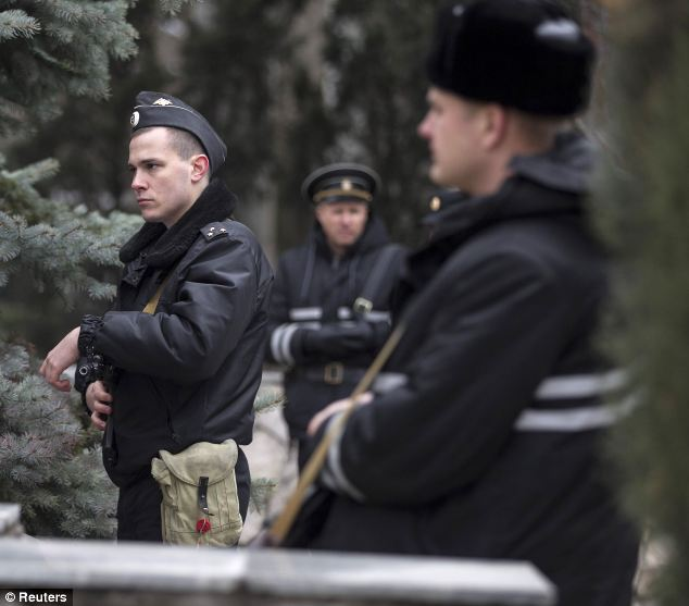 Armed Russian navy servicemen surround a Ukrainian border guard base in Balaclava, in the Crimea region