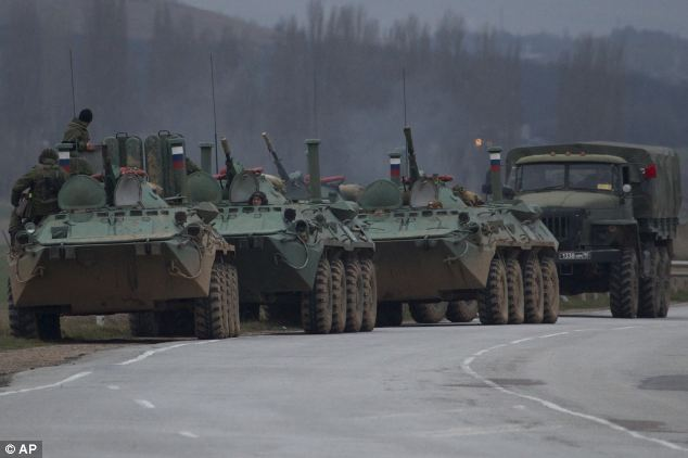 Moving in: part of a convoy or Russian armoured personnel characters parked on a road near the town of Bakhchisarai in Ukraine. Russian authorities said they were not an invading force but to provide 'security'. The convot appeared to be made up of BTR-80 armoured vehicles, which each carry a crew of three, seven infantry soldiers, and are armed with a 30mm machine gun.