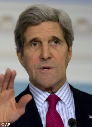 Secretary of State John Kerry gestures as he speaks during a joint news conference