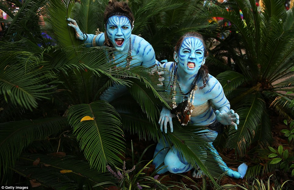 Parade goers dressed as characters from the movie Avatar pose prior to the 2014 Sydney Gay & Lesbian Parade