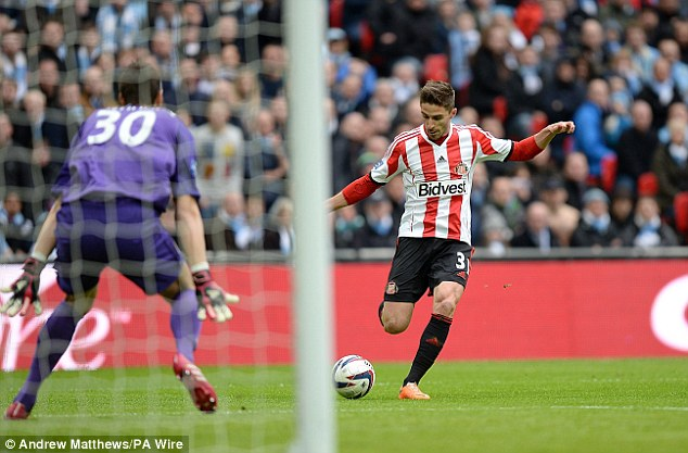 Finish: After shrugging off the challenge from Vincent Kompany, Borini fired into the far corner