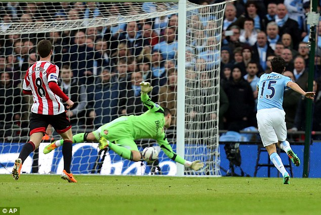 Despairing: Sunderland goalkeeper Mannone tries but fails to keep out the Spaniard's shot