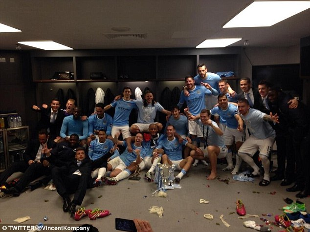 View from the dressing room: Kompany tweeted this picture of City the celebrations