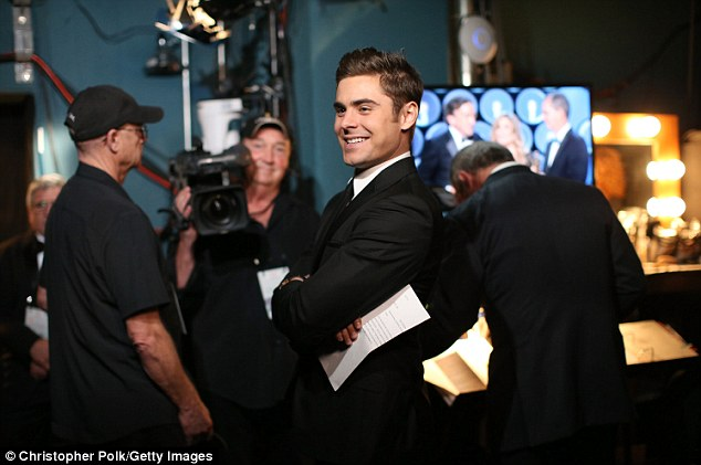 Speaking of teen idols: Zac Efron looked handsome as ever in his black suit as he waited to present backstage