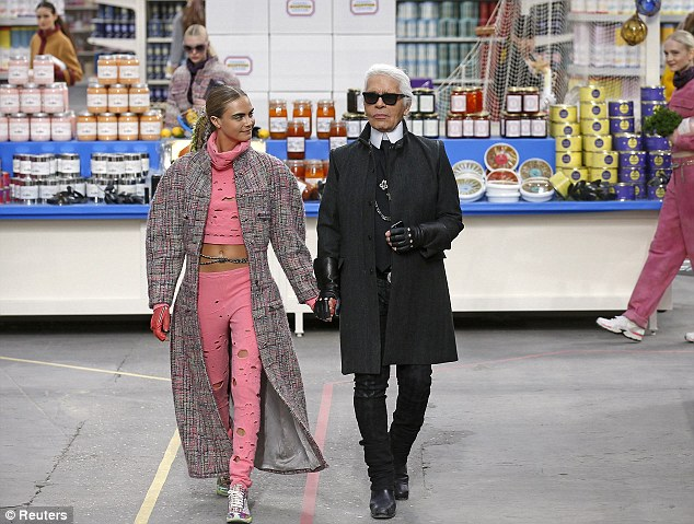 The man himself: Cara finished the show by walking with designer Karl Lagerfeld