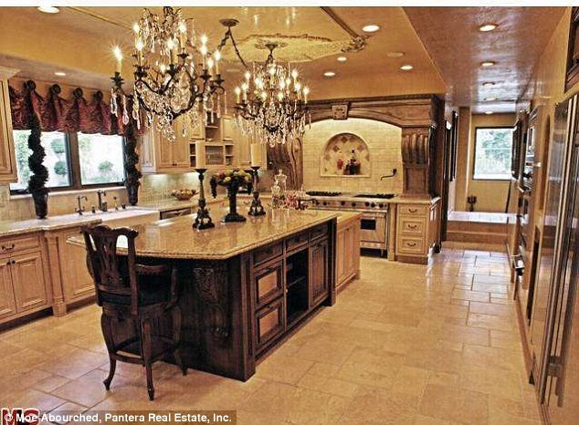 Different style: The property's listing shows what the kitchen really looks like, while the Jenner's kitchen is sleek