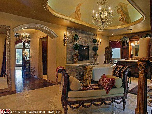 Not their style: While the family may be very grand, it seems they aren't as far as interior design is concerned, as their home is not as lavishly decorated as this