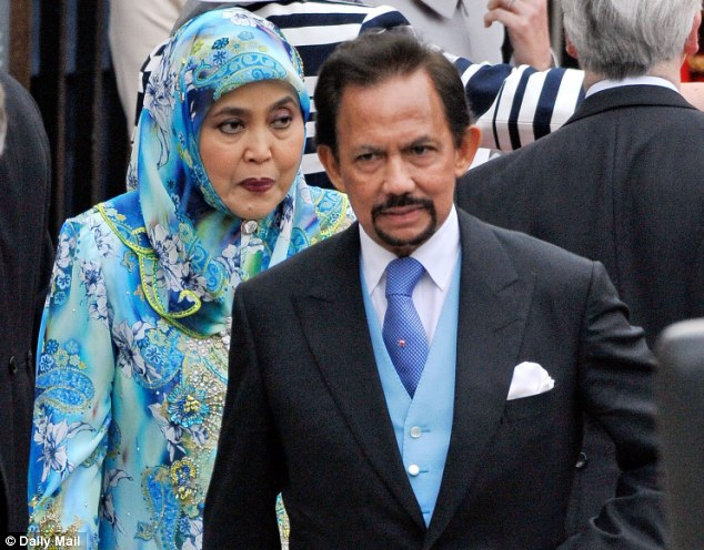 Islamic law: Sultan Hassanal Bolkiah, pictured with his wife at the wedding of the Duke and Duchess of Cambridge, said all races should unite under Sharia law, and that it is a great achievement for Brunei to implement it