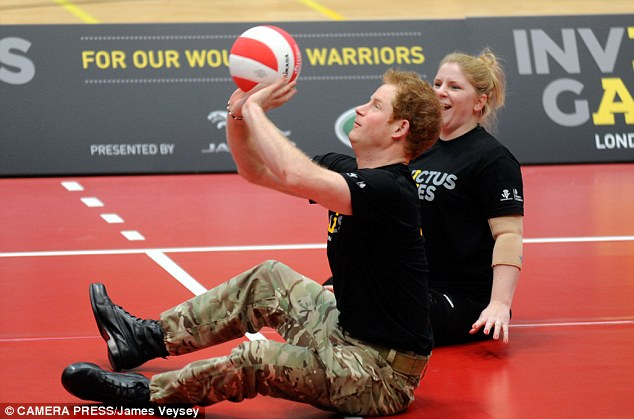 Prince Harry took a hands on approach as he joined in with a game of volleyball at the launch with some of the ex-servicemen and women