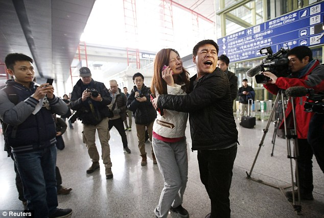 Shock: Distressed relatives wait for news of the Malaysia Airlines plane which was due to land in Beijing. Malaysia's Transport Minister said 14 hours into the massive search and rescue mission, that 'no crash site' has been located