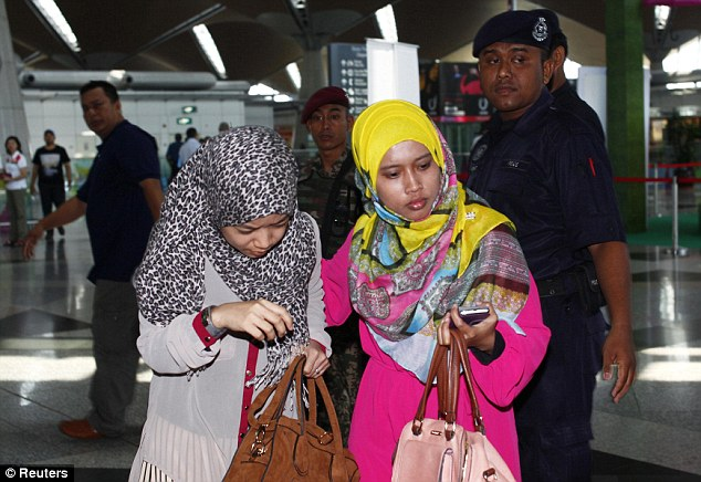 Family room: Women waiting to hear about loved ones on the plane arrive at Kuala Lumpur airport