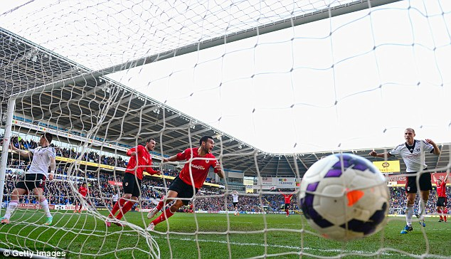 Back of the net: Caulker broke the deadlock for Cardiff in first-half injury time