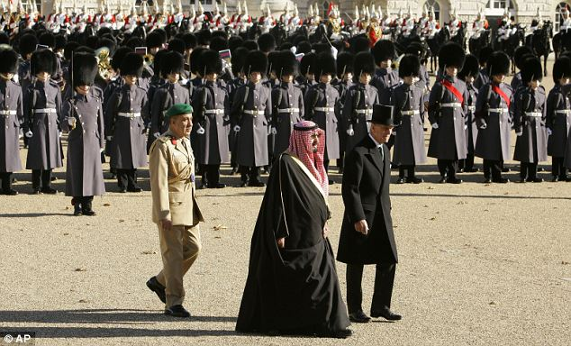 King Abdullah and Prince Philip review a Guard of Honour at Horse Guards, London: Saudi Arabia is a key Middle-East ally of the West. Its royal family enjoy massive wealth, with the king one of the world's richest men