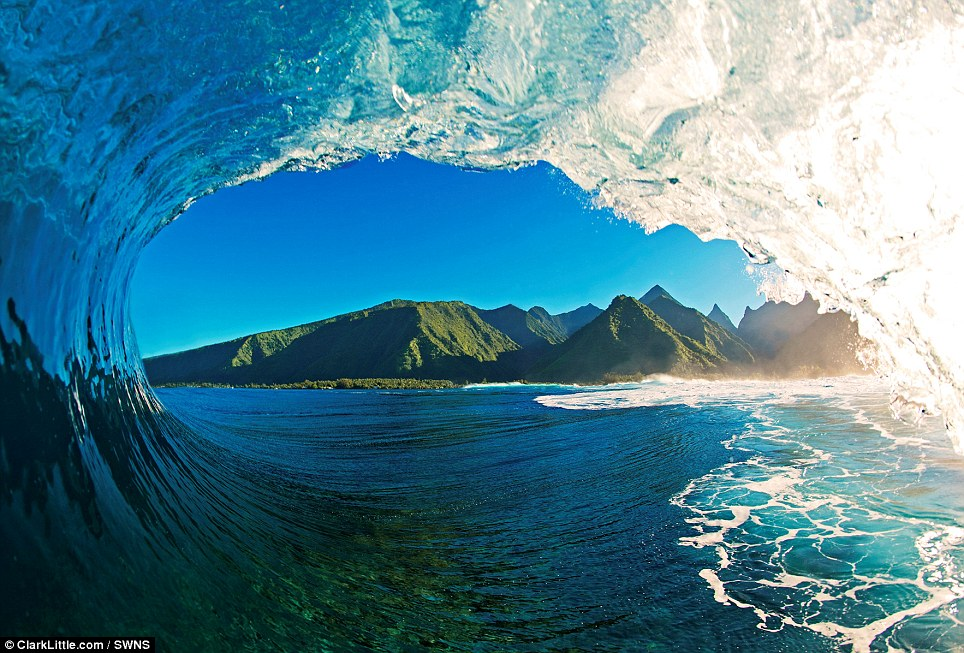 Wave photographer Clarke Little captured this picture during a morning photo session from inside the tube at Teahupoo, Tahiti's most famous surf break. Breaking on a very shallow reef, this spot is known as one of the deadliest waves in the world
