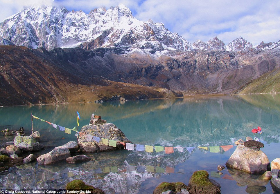 Spiritual: Many of Nepal's famed Himalaya peaks are decorated with Buddhis prayer flags
