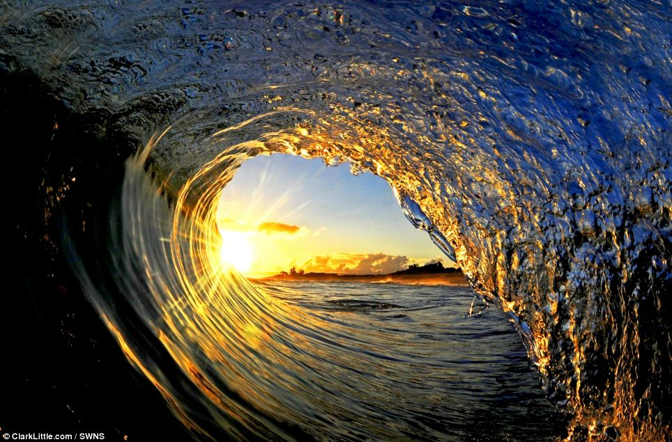 The sun and its rays captured in the arc of the wave on North Shore, Oahu, Hawaii in this early morning shot. Mr Little often leaves his house in the pitch black to capture the sun as it rises