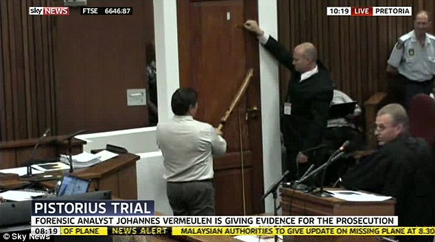 Analysis: The height at which the bat struck the door is measured in court in an attempt by the prosecution to determine whether Pistorius was on his prosthetics at the time