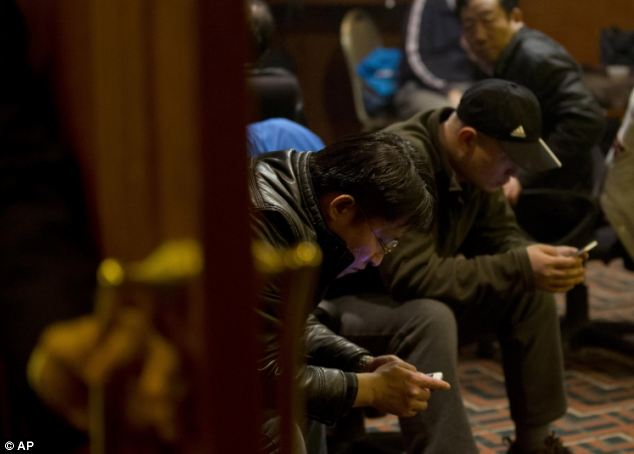 Chinese relatives of passengers aboard the missing flight wait for news at a hotel in Beijing, China