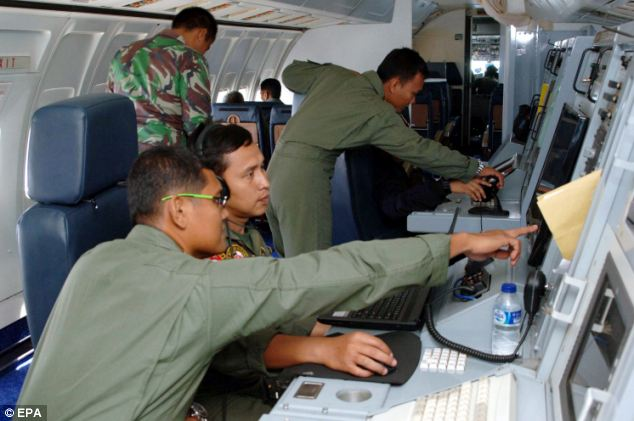 Airforce personnel during a search mission for a Malaysian Airlines aircraft on board a military surveillance plane over the Malacca Straits on Wednesday