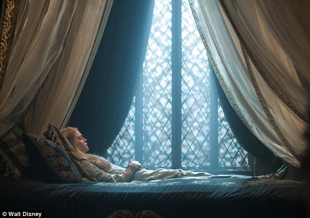 She really is a Sleeping Beauty: Elle lies in bed, playing the part of the fabled princess
