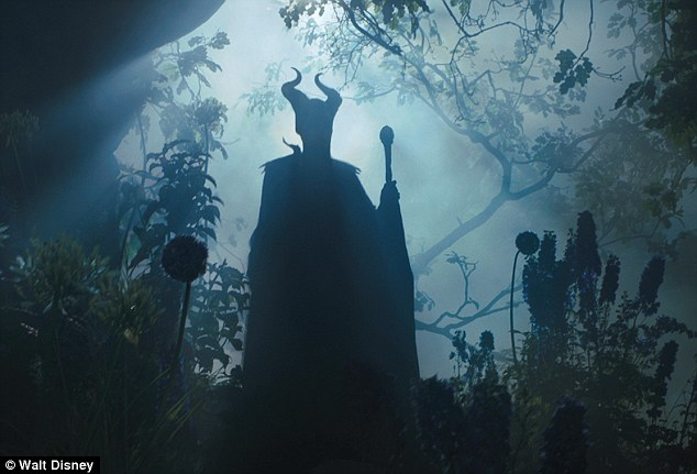 Spooky: Angelina wears horns on her head, and carries a staff as she emerges from the shadows