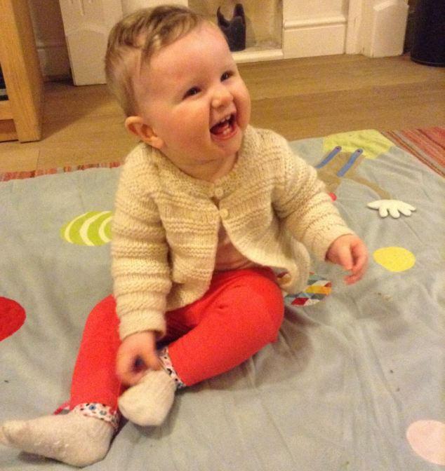 Connie is endlessly delighted by her rattle toy