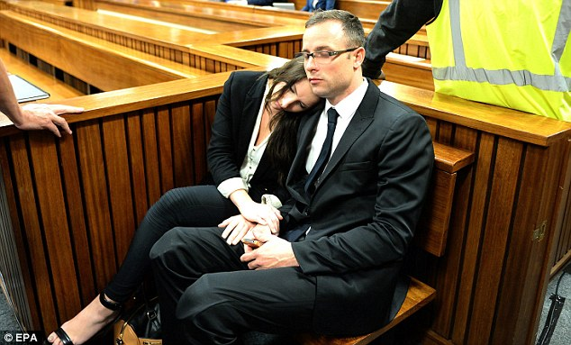 A moment of calm: Pistorius is comforted by his sister Aimee on another emotionally charged day in court